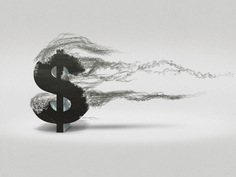 Signe de dollar qui s'efface graduellement.